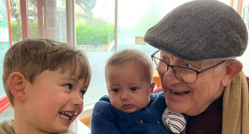 Bobby with his 'at and two great grandsons.