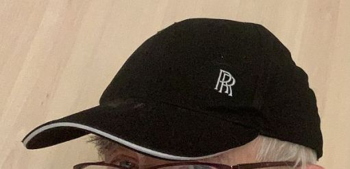 Black Baseball Cap with silver RR logo on it.