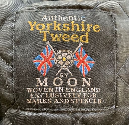 Label of Bobby's Authentic Yorkshire Tweed Cap by Moon. Woven in England exclusively for Marks & Spencer.