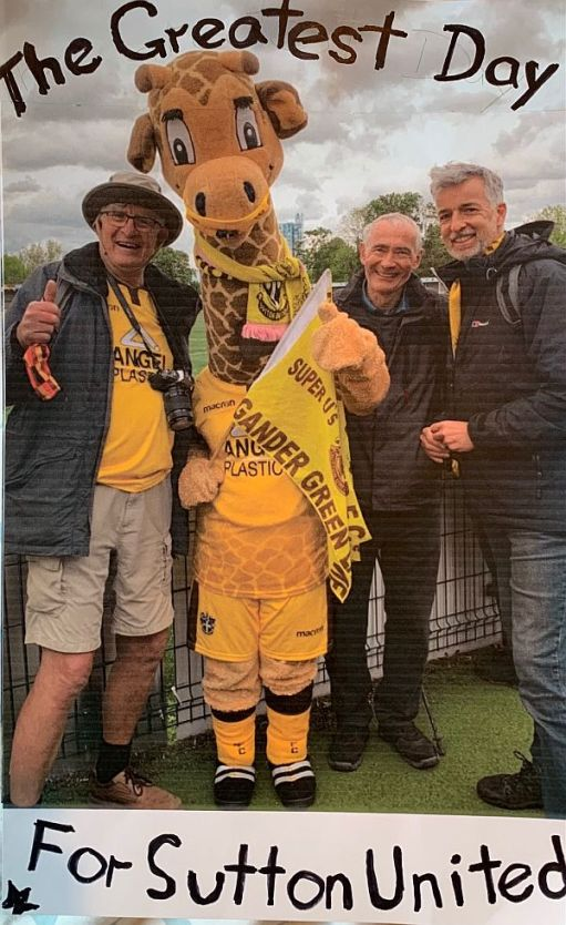 The Greatest Day for Sutton United: Bobby, Jenny (mascot, a giraffe), David, Andrew.