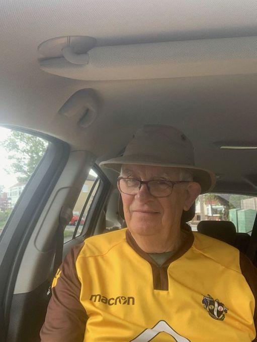 Bob in his Sutton United shirt in his car.
