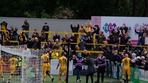 Players and fans celebrating the win.