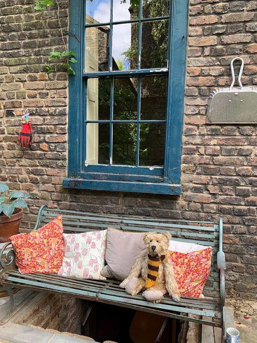 Bertie on a bench in the garden in 31 Fournier Street.