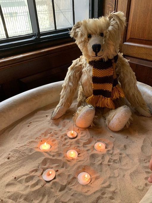 Bertie with candles lit for Diddley. For Amber. For Devante. For Wendy. For Ralph. For Anne.