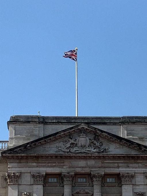 Union Jack flying high on Buckingham Palace.