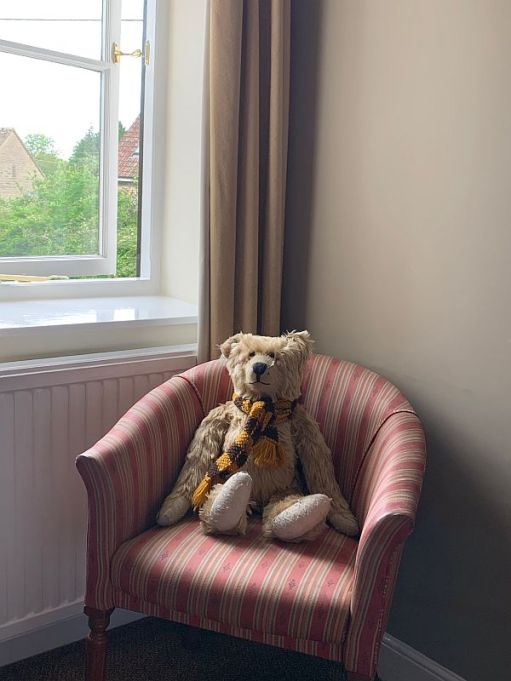 Bertie sat on a chair in the window of their room at the Frocester George.