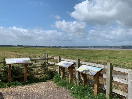 View across Slimbridge with interpretation boards.