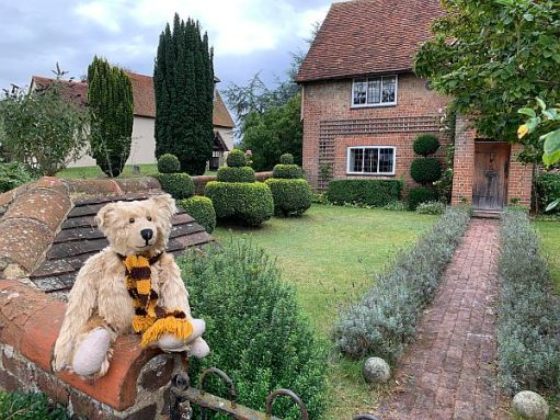 Bertie, wearing his Sutton United Scarf, outside Wisley Church Farm House.
