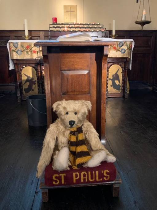 """Bertie on a hassock labelled """"St Paul's""""."""