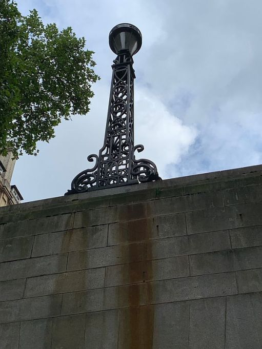 The original lamp standard from 1906 on the entrance wall to the Kingsway Tram Tunnel.