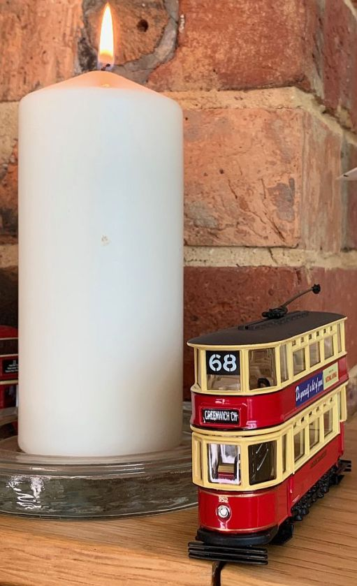 A candle lit for Diddley alongside Bobby's No68 tram 552.