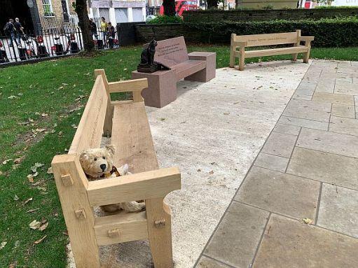 Bertie sat on a bench at the Islington Green Memorial to Bob.
