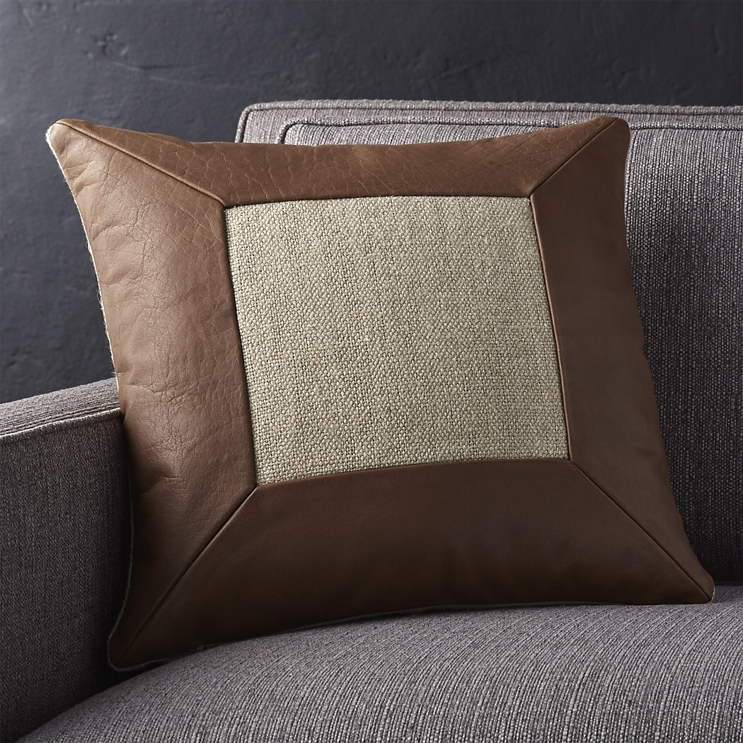 lastly i threw in another neutral and a camel color leather pillow to add another size in the mix the leather pillow also pulls in the color of our dining
