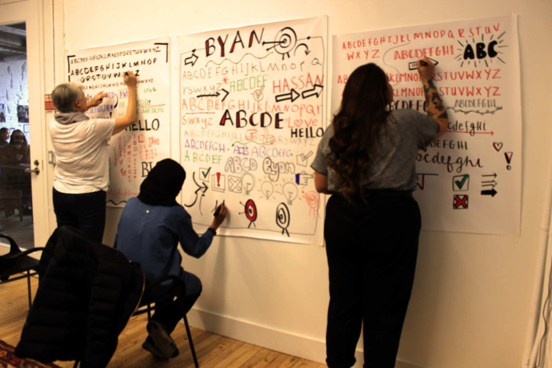 workshop participants learning about lettering and fonts in Toronto