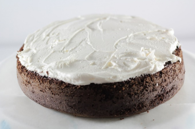 Snoball Cake features a rich chocolate cake, decadent cream filling, vanilla frosting, coconut, and it tastes just like the popular snack cake.