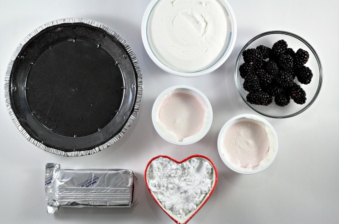 Blackberry Yogurt No Bake Pie features store bought chocolate cookie crust, Greek yogurt, cream cheese, powdered sugar, Cool Whip, and blackberries.