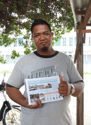 马来居民阿米尔(Amil)对法轮功学员举办的中秋游行表示喜欢。