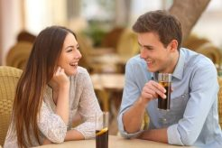 Happy,Couple,Or,Friends,Talking,In,A,Restaurant,And,Looking