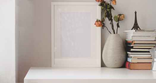 a long white flat board against the wall