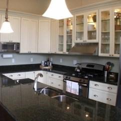 Industrial Kitchen Backsplash Kraft Cabinets A Practical Look At Uba Tuba Granite Countertops For The ...