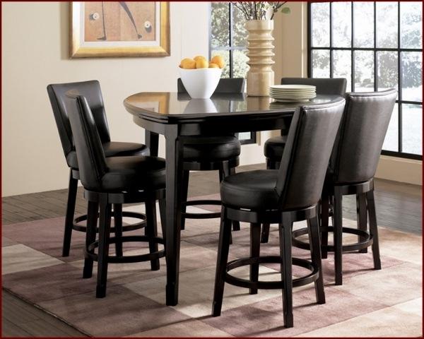 triangular mesa de comedor acabado negro sillas de cuero