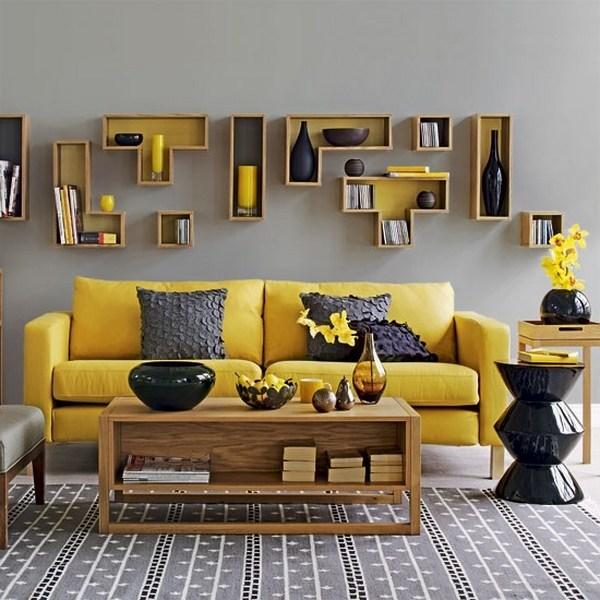 salón amarillo y gris de diseño de interiores pared gris sofá amarillo mesa de centro de madera