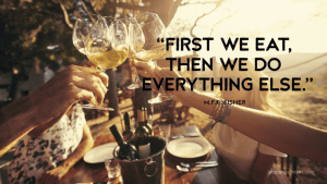hands raising classes to toast with quote 'first we eat, then we do everything else'