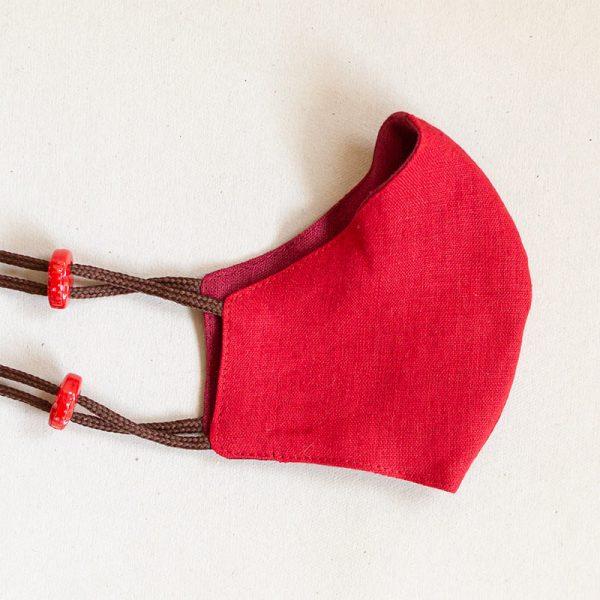 Pellavamaski stopparikiinnityksellä, punaisen sävyt