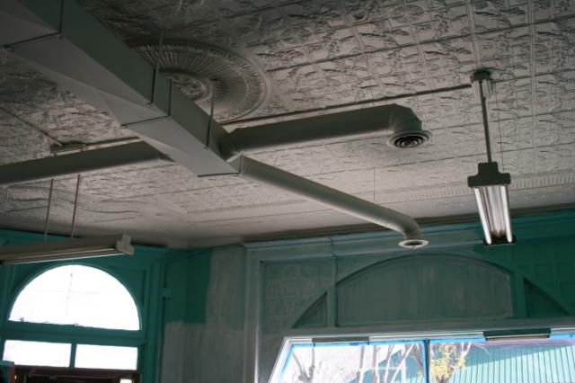 This shows a section of the original tin ceiling in the front part of the buildi