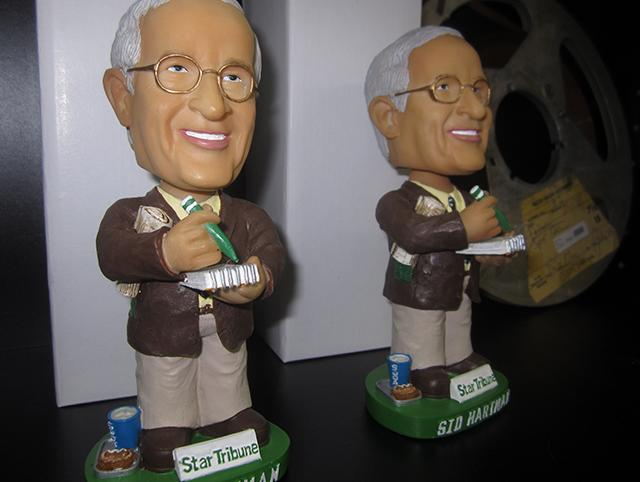 Sid Hartman bobbleheads were available for purchase.