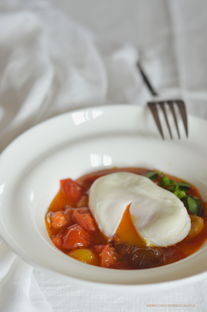 Confit Tomato with Poached Egg in a white plate ready to be served for breakfast