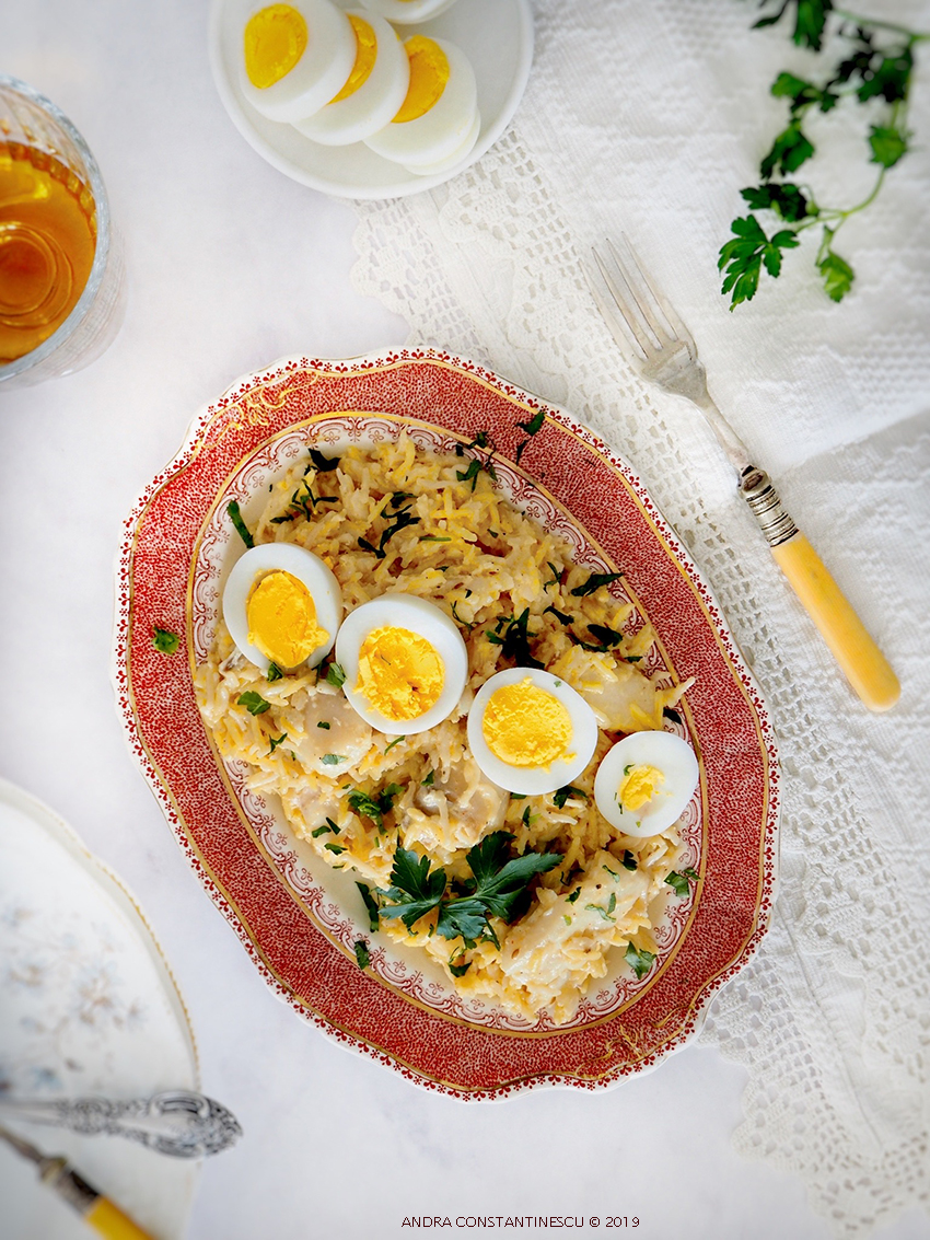 A big platter of smoked cod kedgeree with sliced boiled eggs on top.
