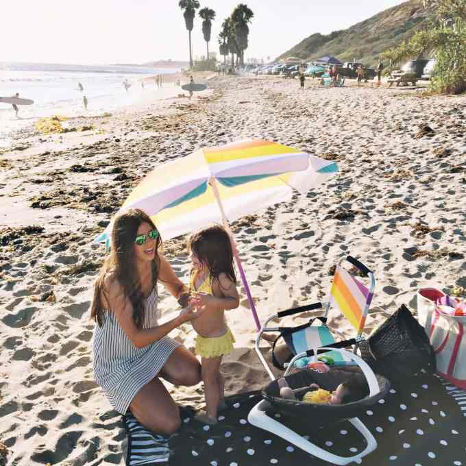 baby hanging out at the beach in a 4moms bounceroo!
