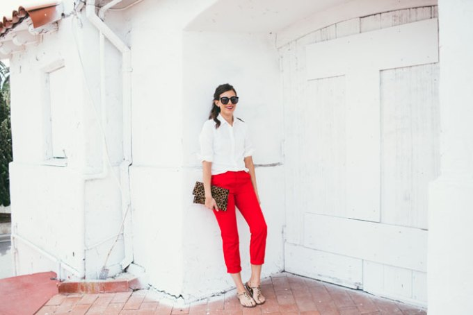 white top and bright red pants