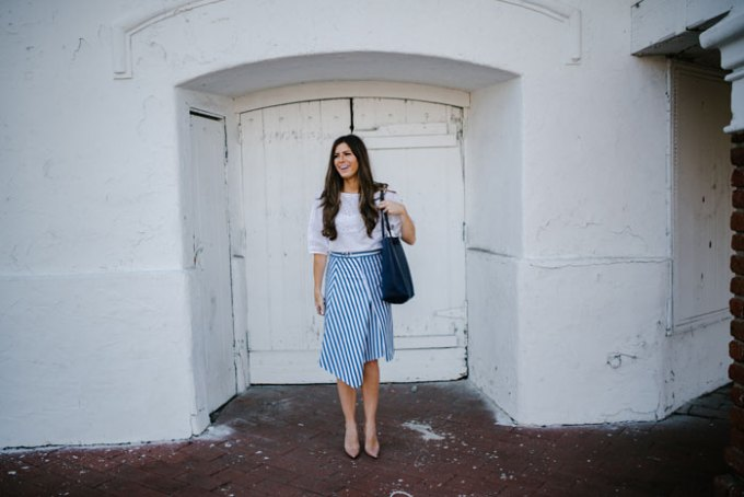 white blouse and striped blue skirt