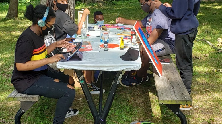 Group of Mint Artists working during the pandemic at our outdoors studio