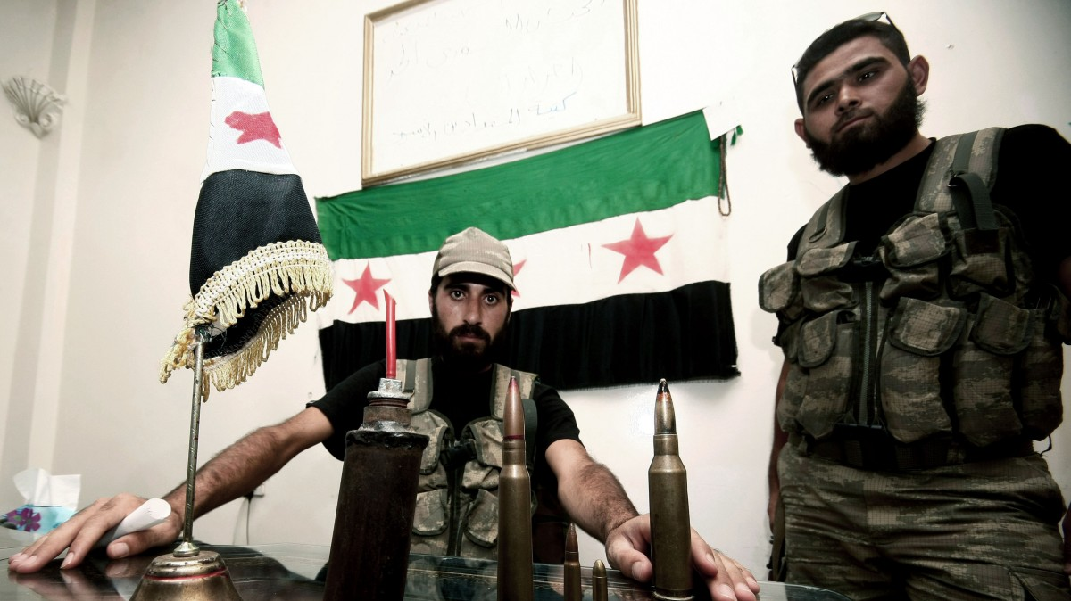 In this Tuesday, July 24, 2012 photo, Free Syrian Army soldiers are seen at the border town of Azaz, some 20 miles (32 kilometers) north of Aleppo, Syria. (AP Photo/Turkpix)