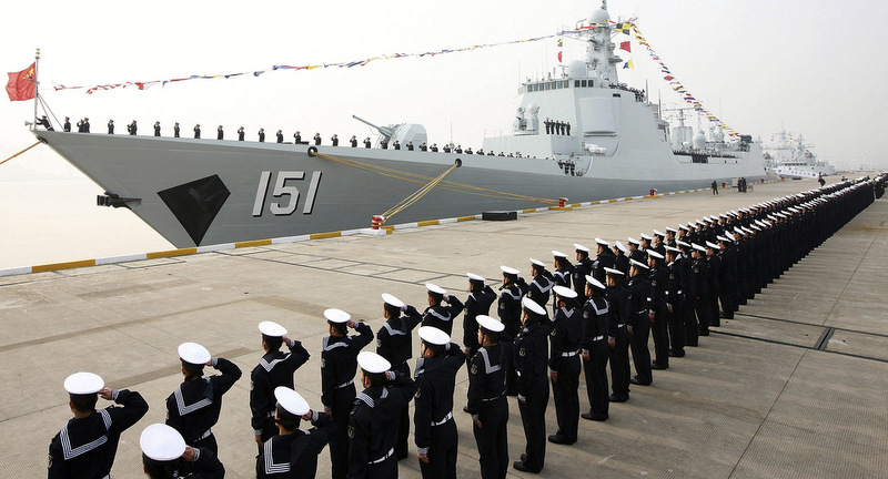 Chinese People's Liberation Army navy personnel salute in front of a new Type 052C guided missile destroyer Zhengzhou during its commission ceremony in Zhoushan, in eastern China's Zhejiang province. (AP Photo)