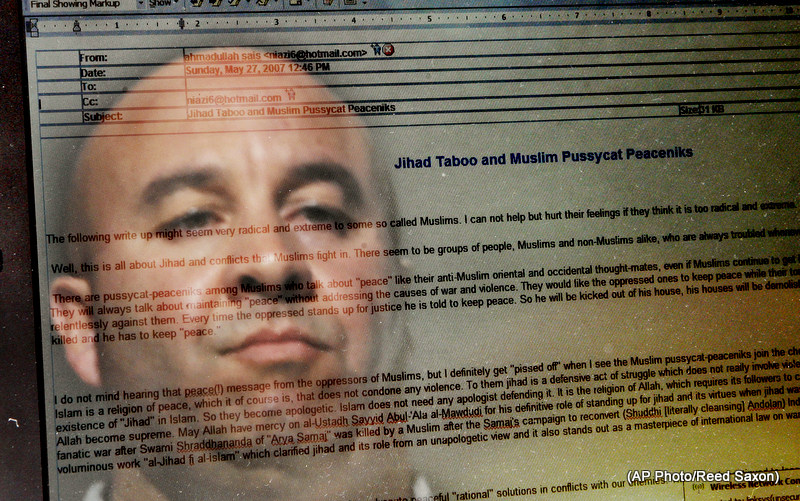 "Craig Monteilh, who says he infiltrated Southern California mosques as an FBI informant and wants to clear his name of suspicions he might have promoted terrorist activities, is reflected in a computer-screen image of an e-mail from Ahmadullah Sais Niazi titled ""Jihad Taboo and Muslim Pussycat Peaceniks,"" in Irvine, Calif., Tursday, Feb. 26, 2009. (AP Photo/Reed Saxon)"