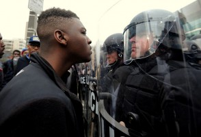 Police and protestors line up against each other across from Camden Yards as protests continue in the wake of Freddie Gray's death while in police custody. (Credit Image: © Algerina Perna/TNS/ZUMA Wire)
