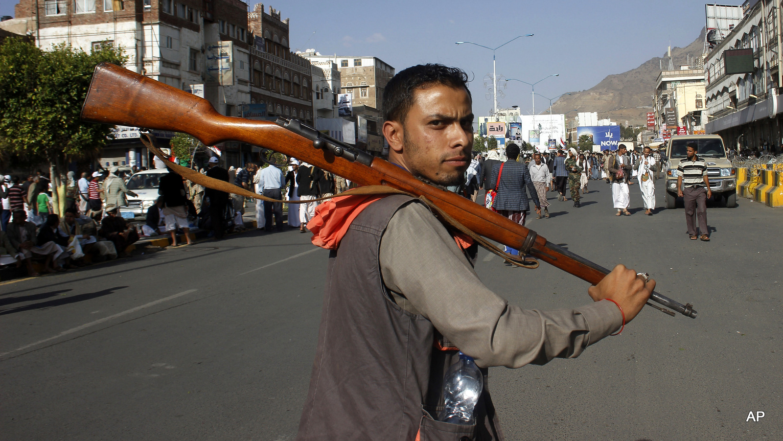 A Houthi Shiite rebel carries his weapon as he joins others to protest against Saudi-led airstrikes, during a rally in Sanaa, Yemen, April 1, 2015. . (AP/Hani Mohammed)