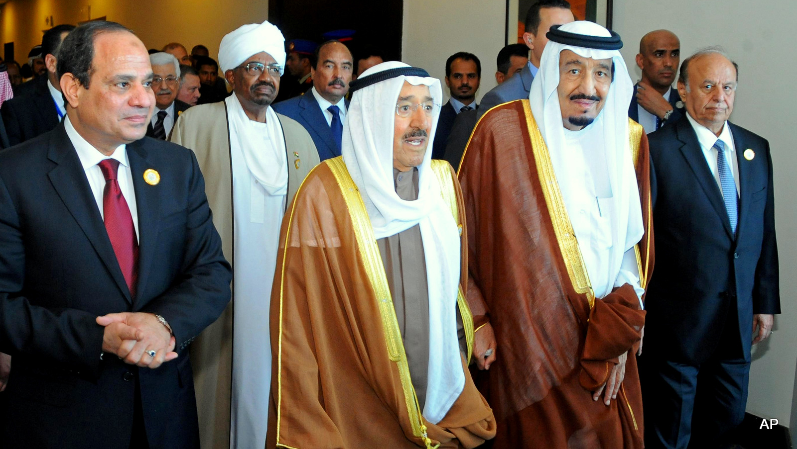 From left to right Egyptian President Abdel-Fattah el-Sissi, Sudanese President Omar al-Bashir, Kuwait's Emir Sheik Sabah Al-Ahmad Al-Jaber Al-Sabah, Saudi King Salman, second and Yemeni President Abdel Rabbo Mansour Hadi, right, walk to an Arab summit meeting in Sharm el-Sheikh, South Sinai, Egypt, Saturday, March 28, 2015.