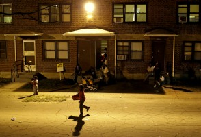 Children play at a party at the public housing complex where Freddie Gray was arrested as a six-day curfew was lifted, Sunday, May 3, 2015, in Baltimore. (AP Photo/Patrick Semansky)