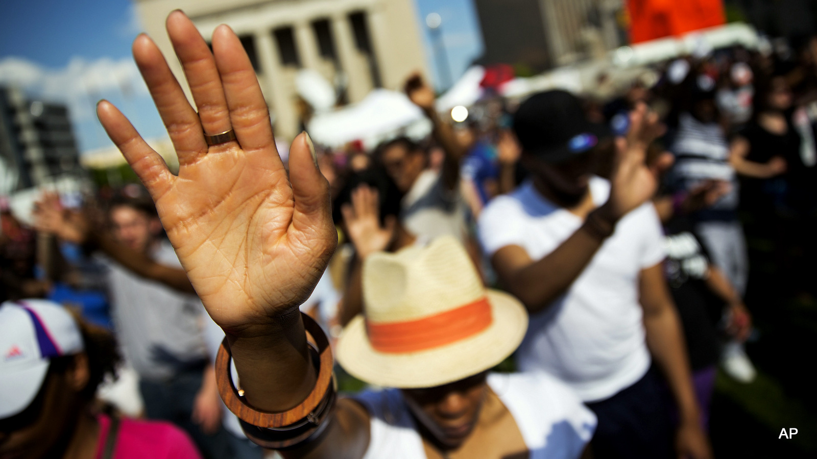 """People pray during a rally at City Hall, Sunday, May 3, 2015, in Baltimore. Hundreds of jubilant people prayed and chanted for justice days after the city's top prosecutor charged six officers involved in Freddie Gray's arrest. Gov. Larry Hogan has called for a statewide """"Day Of Prayer And Peace"""" on Sunday after civil unrest rocked Baltimore."""
