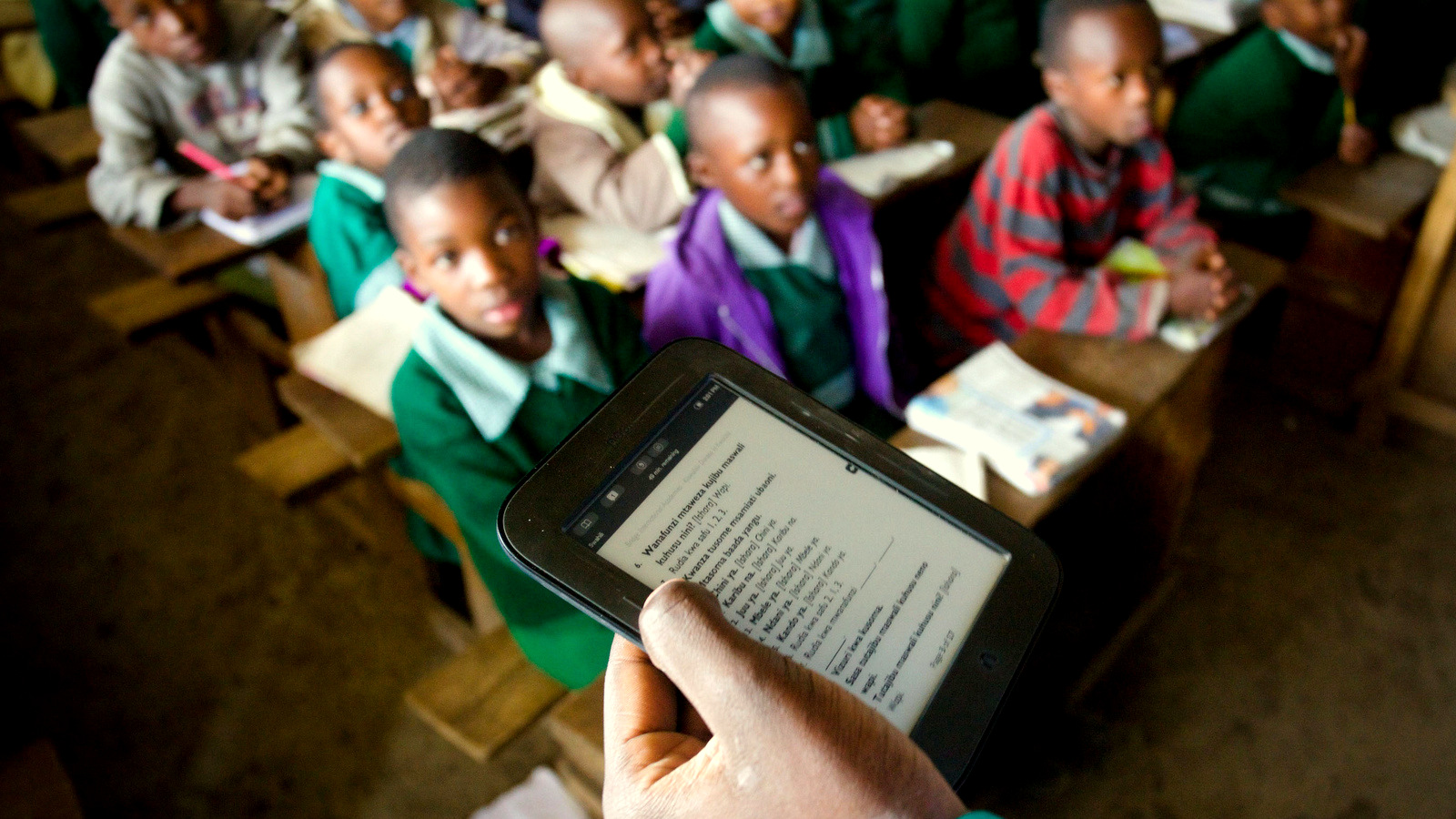 Every lesson is tightly scripted. The teachers deliver lessons by scrolling through the scripts on a tablet. Even small details such as praising students are listed in the class instructions.  (Frederic Courbet/NPR)
