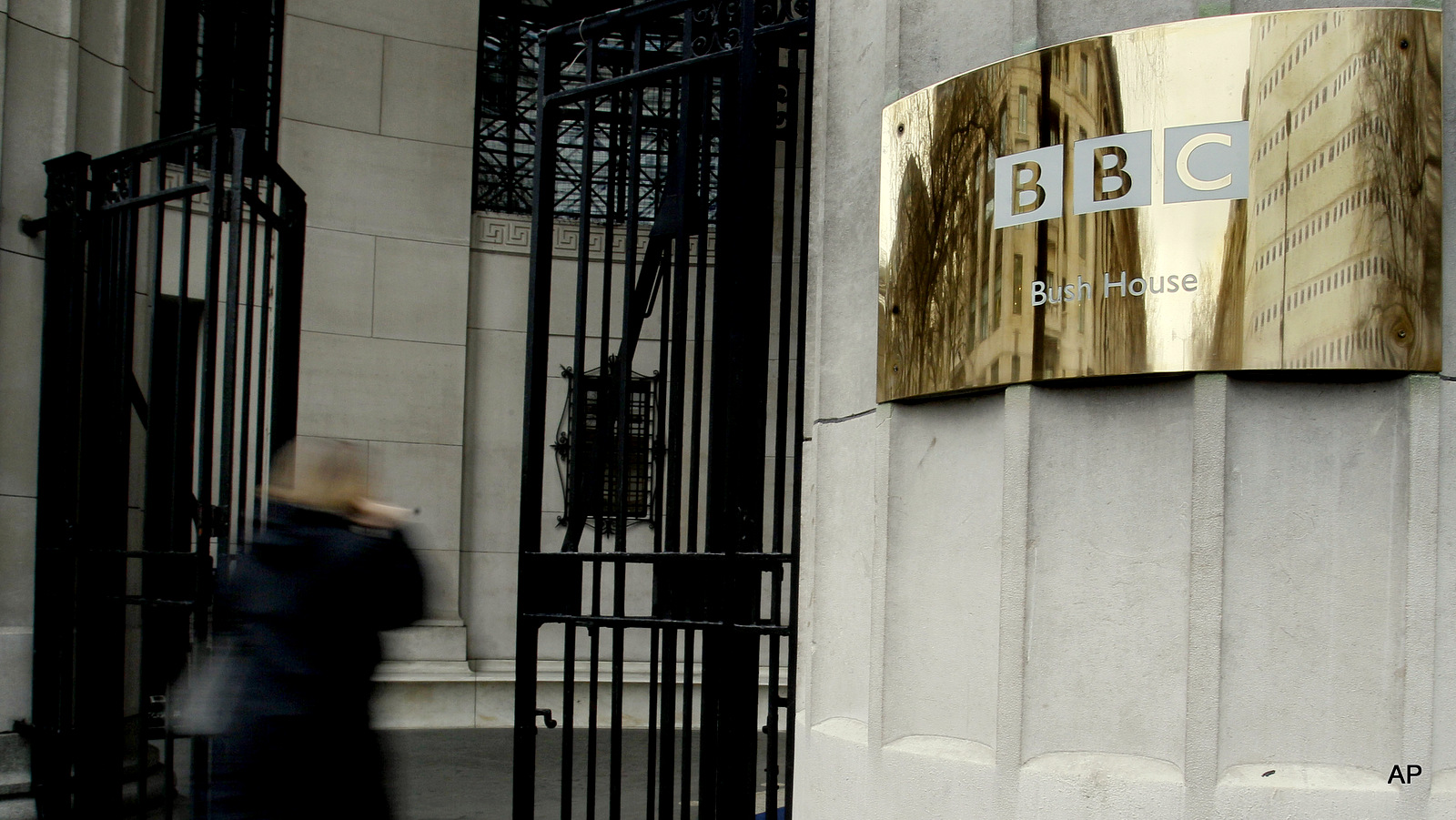 A pedestrian enters the BBC's Bush House in London.