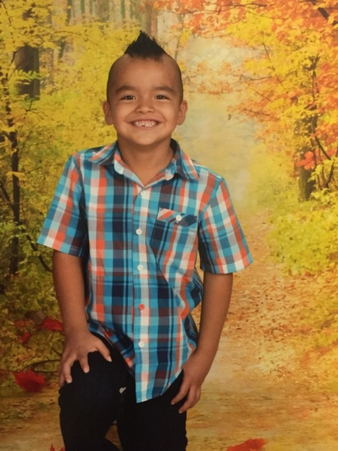 native american boy pulled from class over traditional