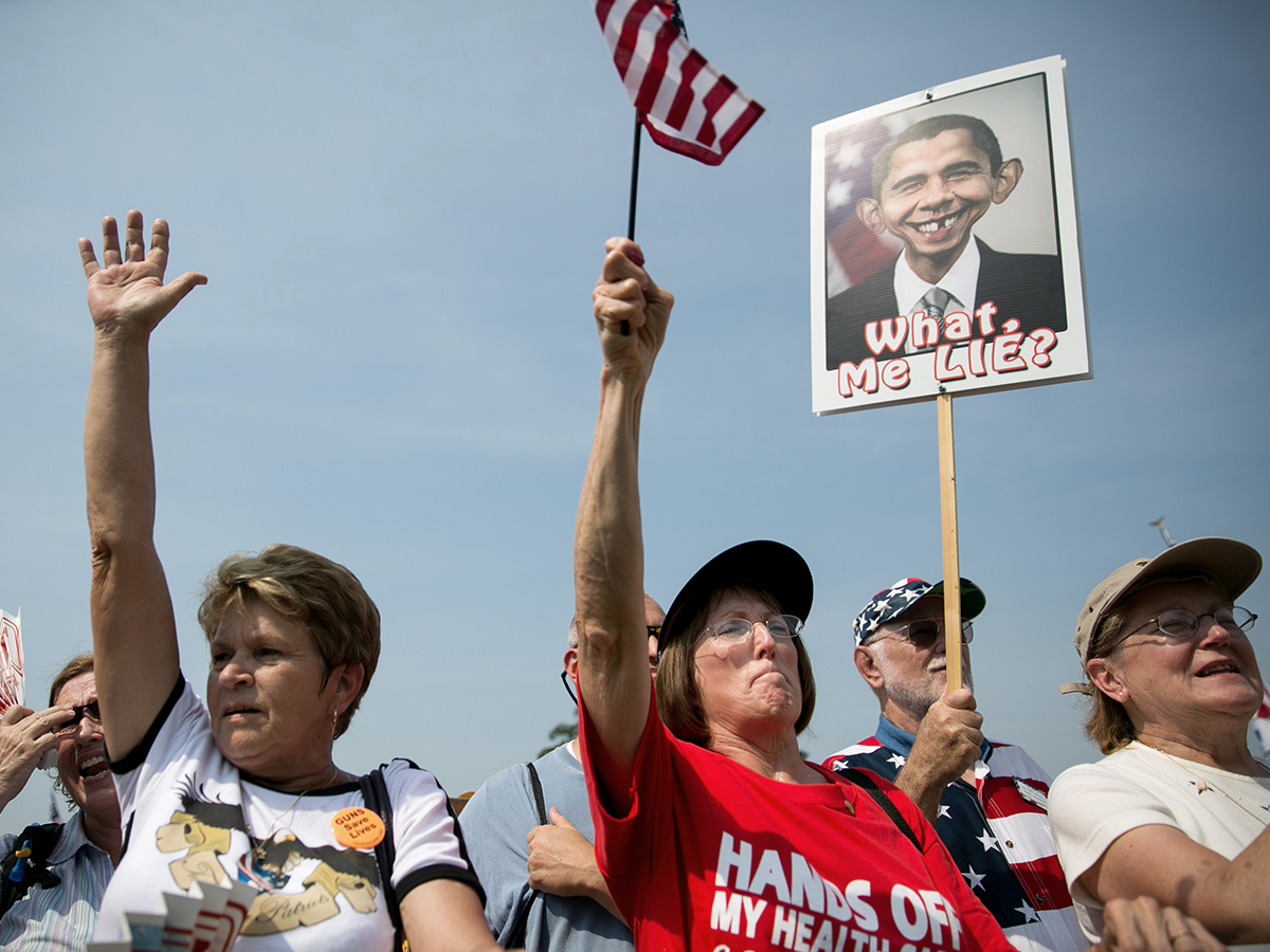 """Tea Party activists cheer during the """"Exempt America from Obamacare"""" rally, on Capitol Hill, September 10, 2013 in Washington, DC. (Photo by Drew Angerer/Getty Images)"""