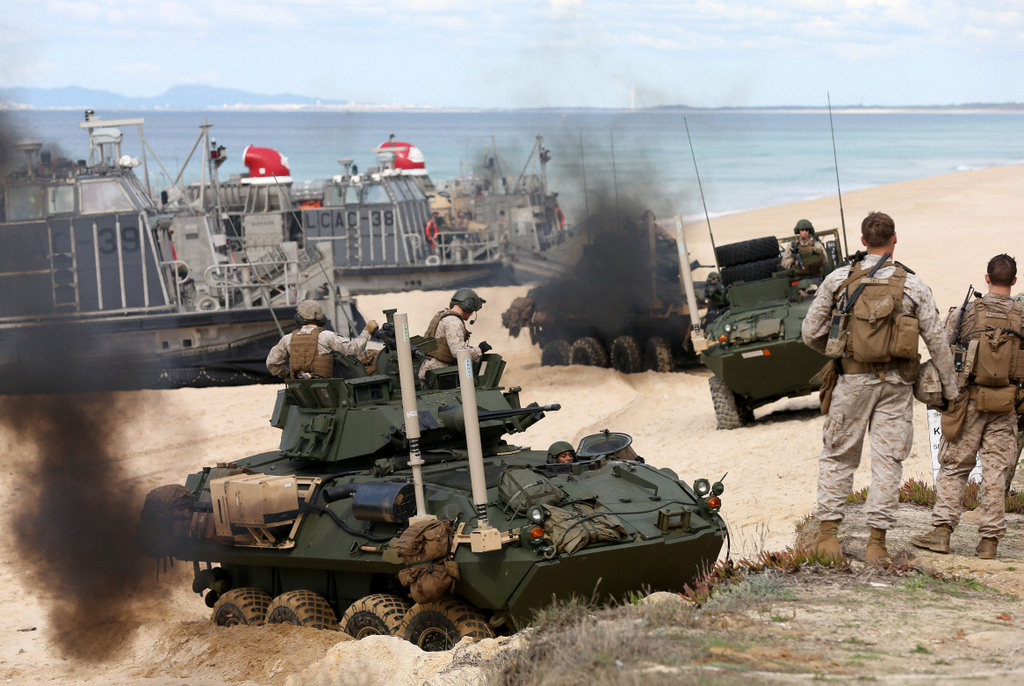 US marine armoured vehicles steers through the soft sand after getting off from a US Navy hovercraft during the NATO Trident Juncture exercise 2015 at Raposa Media beach in Pinheiro da Cruz, south of Lisbon, Tuesday, Oct. 20, 2015. (AP Photo/Steven Governo)