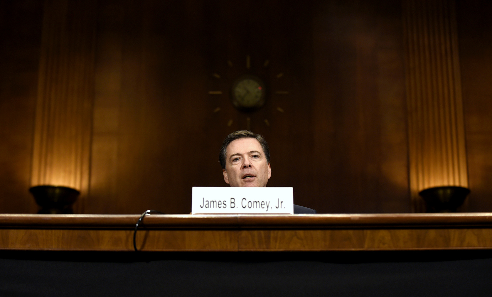 FBI Director James Comey testifies on Capitol Hill in Washington, Wednesday, Dec. 9, 2015, before the Senate Judiciary Committee. Comey said the two San Bernardino shooters were radicalized at least two years ago and had discussed jihad and martyrdom as early as 2013. (AP Photo/Susan Walsh)